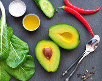 Fresh organic avocado, chili pepper, spinach, seasalt, olive oil, Stock Photo