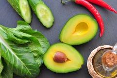 Fresh organic avocado, chili pepper, spinach, seasalt, olive oil,. Fresh organic avocado, chili pepper, spinach, seasalt and olive oil Royalty Free Stock Images