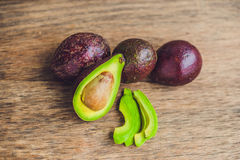 Fresh organic avocado on dark old wooden table, side view Stock Photo