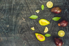 Fresh organic avocado on dark old wooden table, side view Stock Photos