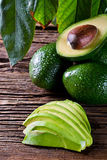 Fresh organic avocado on old wooden table. Stock Images