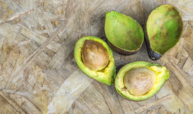 Fresh organic avocado on old wooden table Royalty Free Stock Photography