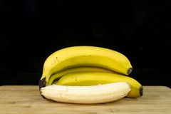 Fresh organic bananas on wood stock photo