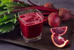 Fresh Organic Beet Juice on a Dark Gray Surface royalty free stock photo