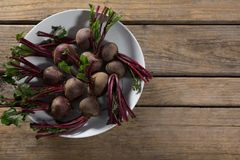 Fresh organic beetroots in a bowl. On wooden table Royalty Free Stock Photography