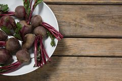 Fresh organic beetroots in a bowl. On wooden table Royalty Free Stock Photo