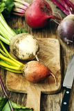 Fresh organic beetroots of different varieties. On wooden cooking board Royalty Free Stock Image
