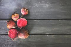 Fresh organic beets. On rustic wooden background Royalty Free Stock Photos