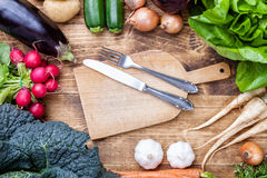 Fresh organic bio vegetables on wooden background. Fresh and organic bio vegetables on a wooden background Stock Photo