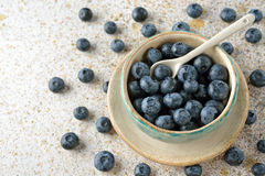 Fresh organic blueberries in a bowl. On a brown background Stock Photography