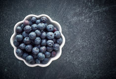 Fresh organic blueberries. Bowl of fresh organic blueberries, top view Stock Photo