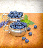 Fresh organic blueberries. In bowls on table Stock Image
