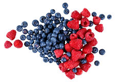 Fresh Organic  Blueberries and Raspberries.  Rich with vitamins. Isolated on white background Stock Photography