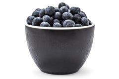 Fresh organic blueberries. Fresh ripe organic blueberries in a frozen black bowl on a white background Stock Photo