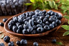 Fresh Organic Blueberries. In a wooden bowl Royalty Free Stock Photos