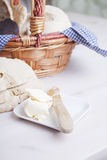 Fresh organic bread and butter in basket Stock Photo