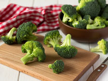 Fresh organic broccoli on white wooden table. Stock Images