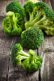 Fresh organic broccoli on a wooden table Royalty Free Stock Photography