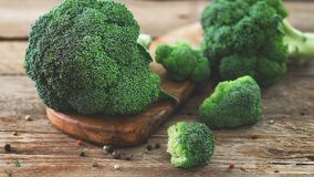 Fresh organic broccoli on wooden table close up.  Stock Photo