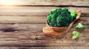 Fresh organic broccoli on wooden table close up with copyspace. Banner.  Royalty Free Stock Photo
