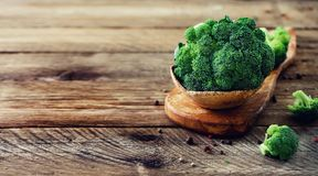 Fresh organic broccoli on wooden table close up with copyspace. Banner.  Stock Photography