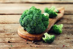 Fresh organic broccoli on wooden table close up with copyspace.  Royalty Free Stock Images