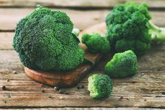Fresh organic broccoli on wooden table close up.  Royalty Free Stock Photos