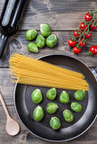 Fresh organic brussel sprouts in a frying pan Royalty Free Stock Photo