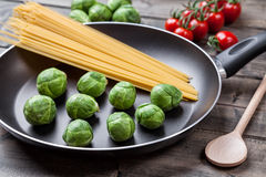 Fresh organic brussel sprouts in a frying pan Royalty Free Stock Photos