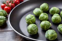 Fresh organic brussel sprouts in a frying pan Royalty Free Stock Image