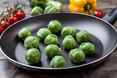Fresh organic brussel sprouts in a frying pan Royalty Free Stock Images