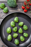 Fresh organic brussel sprouts in a frying pan Stock Photo