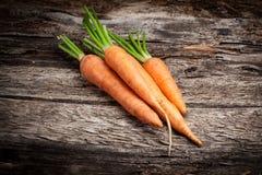 Fresh organic carrots. On wood Stock Images