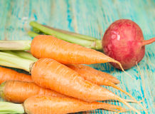 Fresh organic carrots and beetroot. On wooden Stock Images