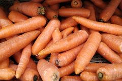 Fresh organic carrots for sale in a supermarket. Close up stock photography