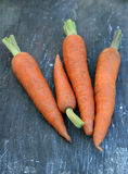 Fresh Organic Carrots on wooden background Stock Photography