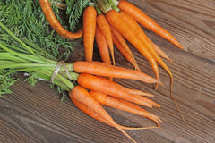 Fresh organic carrots on wooden background, selective focus Royalty Free Stock Images