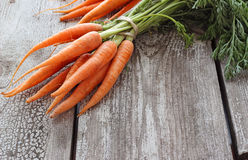 Fresh organic carrots on wooden background, selective focus Stock Images