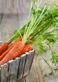 Fresh organic carrots in a wooden box. Royalty Free Stock Images
