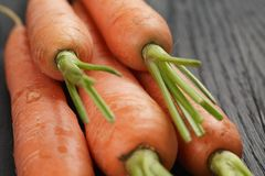 Fresh organic carrots on wooden table Royalty Free Stock Image