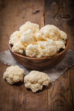 Fresh organic cauliflower. In a bowl on wooden background Royalty Free Stock Photos
