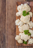 Fresh organic cauliflower. In a bowl on wooden background, top view Royalty Free Stock Photo