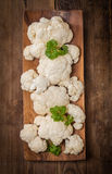 Fresh organic cauliflower. In a bowl on wooden background, top view Royalty Free Stock Image