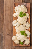Fresh organic cauliflower. In a bowl on wooden background, top view Royalty Free Stock Images