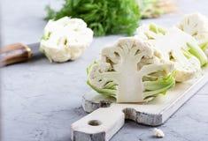 Fresh organic cauliflower on cutting board Royalty Free Stock Image