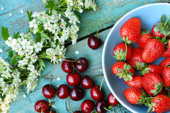 Fresh organic cherries and strawberries Stock Images