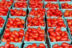 Fresh organic cherry tomatoes background Stock Photos