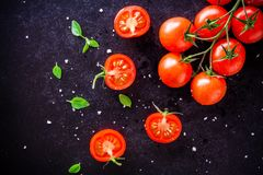 Fresh organic cherry tomatoes with basil and sea salt Stock Photo