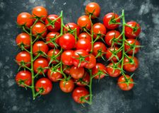 Fresh organic cherry tomatoes on black table royalty free stock photography