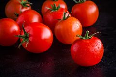 Fresh organic cherry tomatoes with drops closeup Royalty Free Stock Image